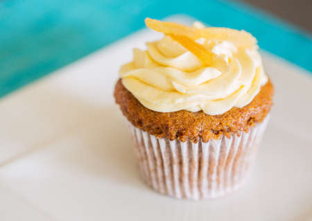 Delicious Beautiful Cupcake on White Plate photo