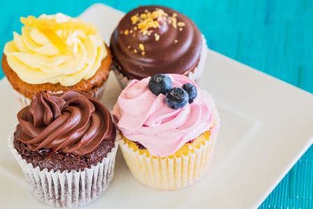 Delicious Assortment of Beautiful Cupcakes photo