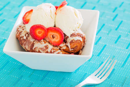 Delicious Cinnamon Roll Sticky Bun with Strawberries and Ice Cream photo