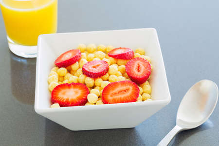 Bowl of Cereal with Fresh Strawberries photo