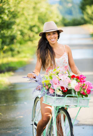 Beautiful Girl on Bike in Countryside, Summer Lifestyle  photo