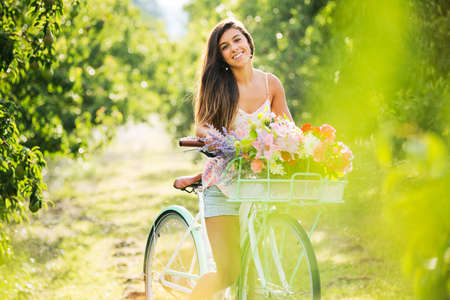 Beautiful Girl on Bike in Countryside, Summer Lifestyle  Stock Photo - 21512148