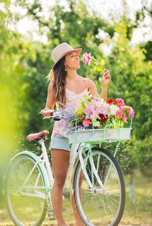 Beautiful Girl on Bike in Countryside, Summer Lifestyle  Stock Photo - 21512153