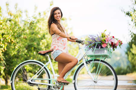 Beautiful Girl on Bike in Countryside, Summer Lifestyle Reklamní fotografie - 21578654