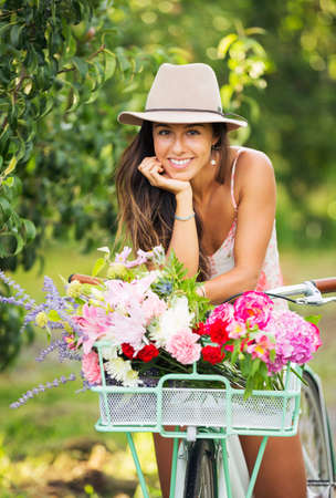 spring hat: Beautiful Girl on Bike in Countryside, Summer Lifestyle