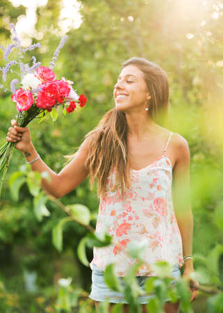 Beautiful Young Woman with Flowers in Countryside, Summer Lifestyle