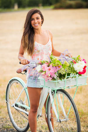 Beautiful Girl with Bike in Countryside, Summer Lifestyle  photo