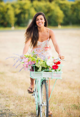 Beautiful Young Woman on Bike in Countryside, Summer Lifestyle