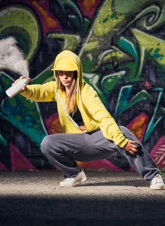Graffiti Artist with Spray Paint