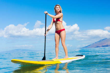 Attractive Woman on Stand Up Paddle Board, SUP, Tropical Blue Ocean, Hawaii photo