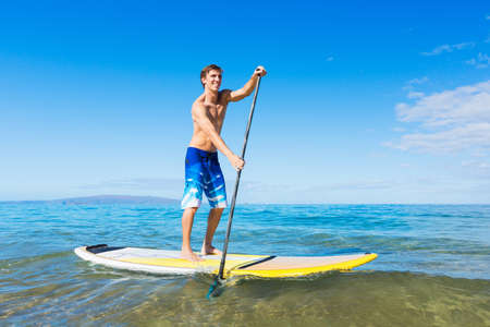 Attractive Man on Stand Up Paddle Board, SUP, Tropical Blue Ocean, Hawaii Reklamní fotografie