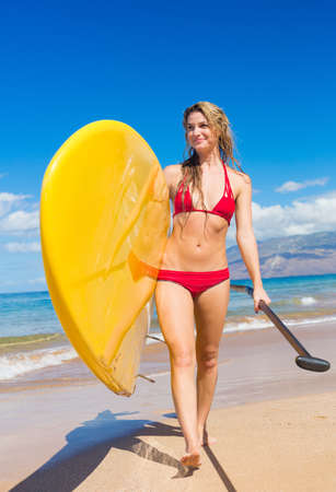 paddleboard: Attractive Woman with Stand Up Paddle Board, SUP, on the beach in Hawaii
