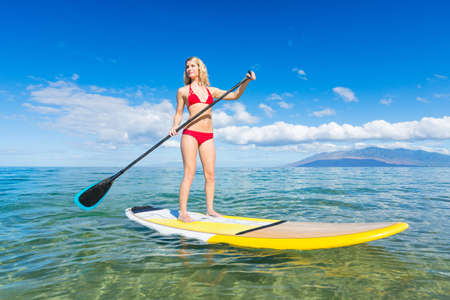 Attractive Woman on Stand Up Paddle Board, SUP, Tropical Blue Ocean, Hawaii