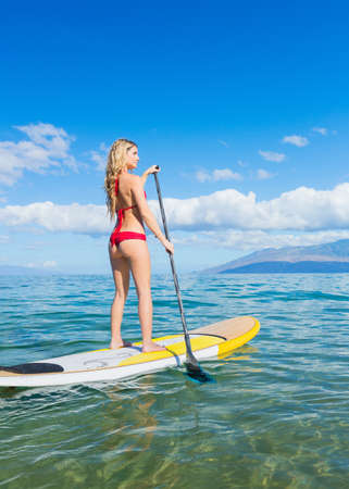 paddling: Attractive Woman on Stand Up Paddle Board, SUP, Tropical Blue Ocean, Hawaii