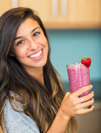 smoothie strawberry: Beautiful Young Woman with Fruit smoothie