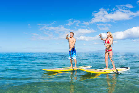 paddle: Attractive Couple Stand Up Paddling in Hawaii