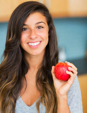 Portrait of beautiful woman with an apple, Healthy Lifestyle Concept photo