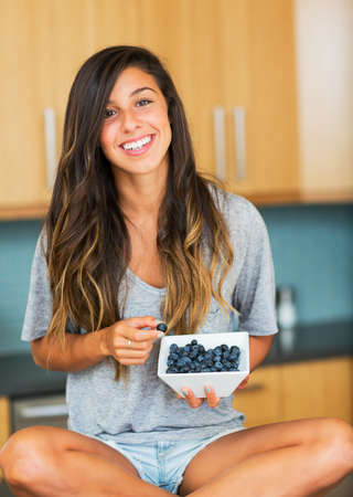 many hands: Beautiful woman eating blueberries, Healthy Food Lifestyle Stock Photo