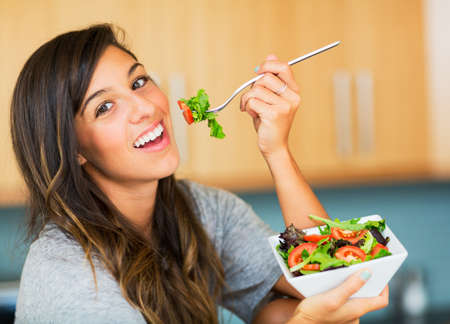 beautiful salad: Beautiful healthy woman eating salad, Dieting Concept. Healthy Lifestyle.