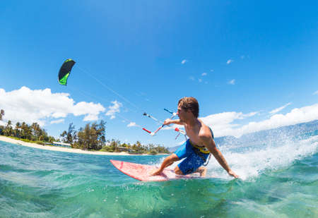 Young Man KiteBoarding, Fun in the ocean, Extreme Sport Kitesurfing