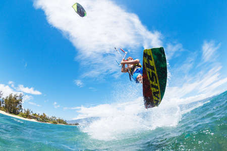 Young Man KiteBoarding, Fun in the ocean, Extreme Sport Kitesurfing photo
