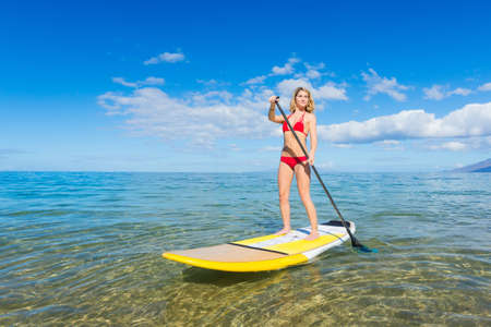 paddleboard: Young Attractive Woman on Stand Up Paddle Board, SUP, in the Blue Waters off Hawaii, Active Life Concept