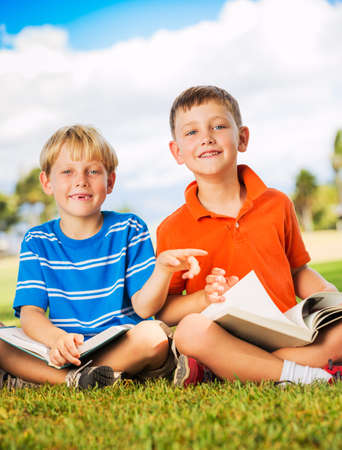 Happy Kids, Young Boys Reading Books Outside, Friendship and Learning Concept photo