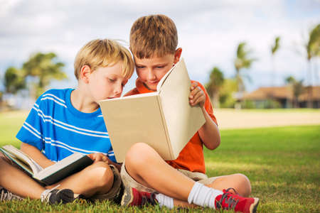 Happy Kids, Young Boys Reading Books Outside, Friendship and Learning Concept