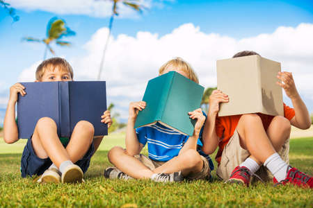 kids reading: Group of Happy Kids Reading Books Outside, Friendship and Learning Concept