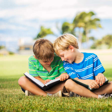 glade: Happy Kids, Young Boys Reading Books Outside, Friendship and Learning Concept