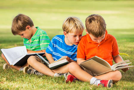 Group of Happy Kids Reading Books Outside, Friendship and Learning Concept photo