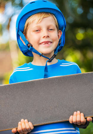 skate board: Cute Young Boy with Skate Board Stock Photo