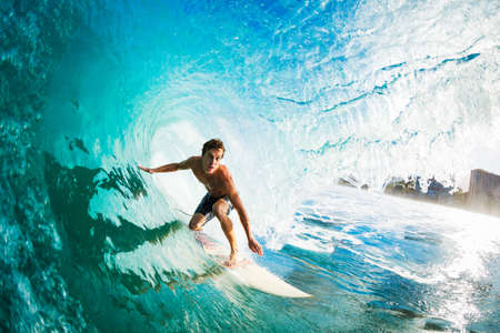 surfing beach: Surfer on Blue Ocean Wave in the Tube Getting Barreled
