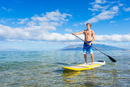 paddle: Attractive Young Man Stand Up Paddle Surfing In Hawaii, Beautiful Tropical Ocean, Active Beach Lifestyle