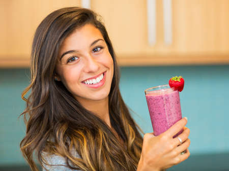 Woman Drinking Fresh Fruit Smoothie photo