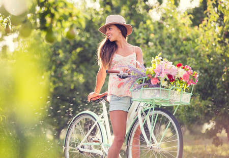 road bike: Beautiful young woman on bike in park