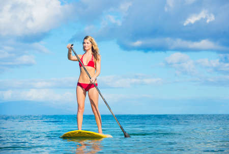 paddleboard: Attractive Young Woman Stand Up Paddle Surfing In Hawaii, Beautiful Tropical Ocean, Active Beach Lifestyle Stock Photo