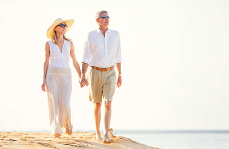 aging woman: Happy Romantic Middle Aged Couple Enjoying Walk on the Beach