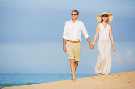 aged: Happy Romantic Middle Aged Couple Enjoying Walk on the Beach, Vacation Retirement Concept
