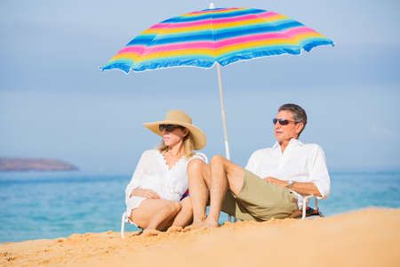 getaways: Happy Romantic Middle Age Couple Relaxing on Tropical Beach, Vacation Concept