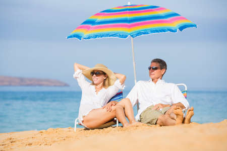 Happy Romantic Middle Age Couple Relaxing on Tropical Beach, Vacation Concept photo