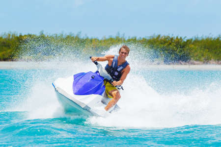 Man on Jet Ski having fun in Ocean Stock Photo
