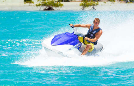 water jet: Man on Jet Ski having fun in Ocean Stock Photo