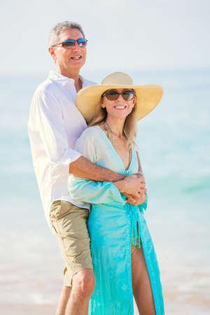 Happy Romantic Couple Walking on the Beach photo