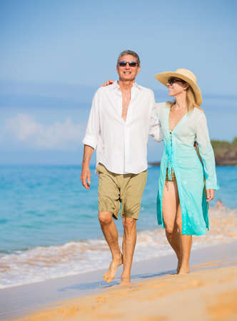 Happy Romantic Couple Walking on the Beach photo