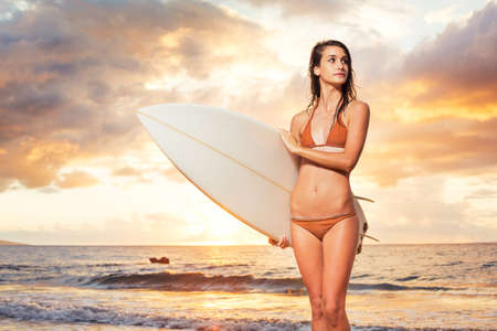 Beautiful Surfer Girl on the Beach at Sunset  photo