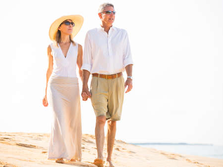retirement couple: Happy senior couple on the beach. Retirement Luxury Tropical Resort