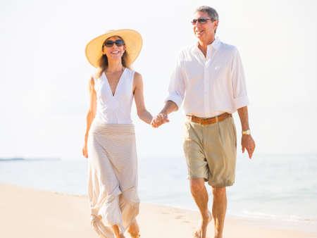 Happy senior couple on the beach. Retirement Luxury Tropical Resort photo