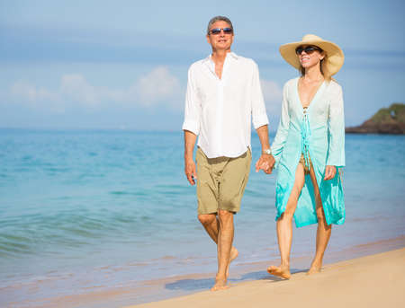 Happy senior couple on the beach. Retirement Luxury Tropical Resort photo
