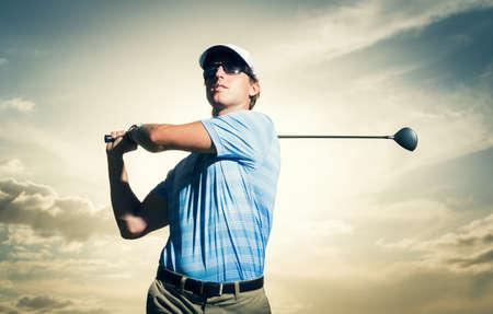 fairway: Golfer at sunset, Man swinging golf club with dramatic sunset sky